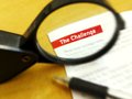 Focus on challenge a photograph showing a magnifying glass focused the word the in white red background and clear print taken with Royalty Free Stock Photos