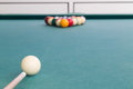 Focus on cue aiming white ball to break snooker billards Royalty Free Stock Photo