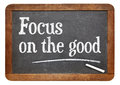 Focus on the good positivity concept text a vintage slate blackboard Royalty Free Stock Images