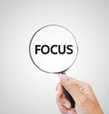 Focus letters under the magnifier Royalty Free Stock Photos