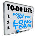 Focus on the long term words dry erase board to do list written a illustrate investing and working toward lasting results or Stock Photo