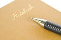 Focus note book gold color with pen on white background Royalty Free Stock Photo