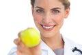 Focus shot on nurse holding apple Royalty Free Stock Photo