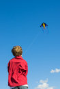 Focus on success boy concentrating to fly a kite Royalty Free Stock Photos