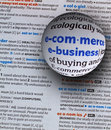 Focus on word e commerce and e business on dictionary page by a glass globe magnifying and highlighting Royalty Free Stock Image