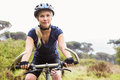 Focused athletic blonde mountain biking Royalty Free Stock Photo