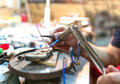 Focused brazing in progress at jewelry workshop Royalty Free Stock Photo