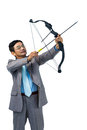 Focused businessman shooting a bow and arrow Royalty Free Stock Photo