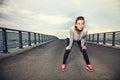 Focused female runner resting outdoors on the bridge Stock Images