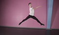 Focused male ballet dancer leaping in the dance studio Royalty Free Stock Photography