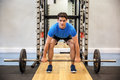 Focused man about to lift a barbell Royalty Free Stock Photo