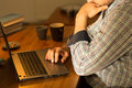 Focused man using laptop close up of sitting at desk Royalty Free Stock Photography