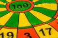 Focused on target one hundred point middle of dartboard Stock Photos