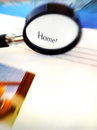Focusing on home a magnifier used to focus the word concept image for searching and looking for new or house simple composition Stock Images