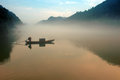 Fog floating over little east river the is located in the northern entrance of dongjiang lake scenic area it is a narrow lake with Stock Photography