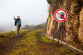 Fog hazard sign on a foggy mountain walking path Royalty Free Stock Photography