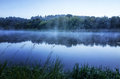 Fog on the lake covered by mystic it Stock Images