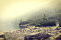 Fog over mountains lake. Royalty Free Stock Photo