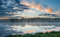 Fog over the river at sunset Royalty Free Stock Photo