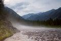 Fog over a rocky mountain stream. Royalty Free Stock Photo