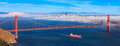 Fog over san francisco rolling golden gate bridge and on a late summer afternoon Stock Photography