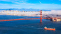 Fog over san francisco rolling golden gate bridge and on a late summer afternoon Stock Photos