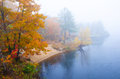 Foggy autumn day at river a in new england Stock Images