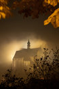 Foggy church old at night covered wth clouds Royalty Free Stock Photos