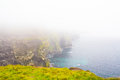 Foggy cliffs of moher landscape in ireland in a very day Royalty Free Stock Photography
