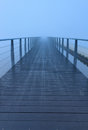 Foggy footbridge empty modern over a lake Royalty Free Stock Photos
