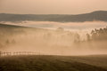 Foggy hills in autumn dawn czech and valleys with fence Royalty Free Stock Image