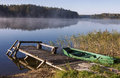 Foggy lake with bridge and boat Royalty Free Stock Photo