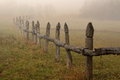 Foggy landscape old rustic fence on a morning Royalty Free Stock Photos