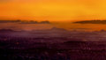 Foggy sunset over mountain range Royalty Free Stock Images