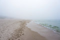 Foggy weather by the sea baltic beach in leba poland Royalty Free Stock Image