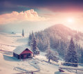 Foggy winter scene in the mountain farm. Royalty Free Stock Photo