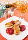 Foie gras on a big white dish Stock Images