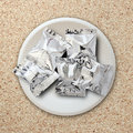 Foil package on white plate bag Royalty Free Stock Image