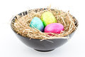 Foil wrapped easter eggs bowl straw Stock Photography