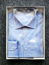 Folded Blue Button Down Shirt in Open Box Royalty Free Stock Photo