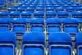 Folded chairs rows of blue Stock Image