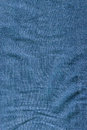 Folded denim texture close up of blue Stock Image