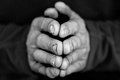 Folded hands i closeup of in black and white Stock Images