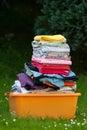 Folded laundry in basket Royalty Free Stock Photo