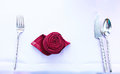 Folded Rose shape napkin with spoon, fork and knife Royalty Free Stock Photo
