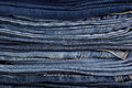 Folded stack of jeans in the background Stock Image