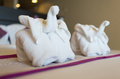 Folded towel elephant on the bed Royalty Free Stock Photo