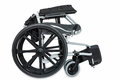 Folded wheel chair black on white background with clipping path Royalty Free Stock Photography