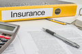 A folder with the label Insurance Stock Photo