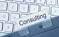 Folder labeled consulting gray with printed label marked with computer keyboard behind Royalty Free Stock Photography